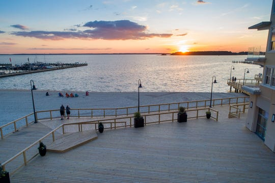 Lighthouse Cove's Dewey Beach redevelopment, including a new public  Baywalk, replenished beach and recreational pier, are now open. A sunset gazebo is still under construction.