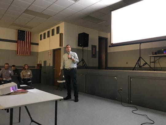 Drew Gibbons, development director for Kansas-based Savion, talks to Saratoga residents about a proposed solar energy project planned for land currently owned by the Wysocki Family of Companies