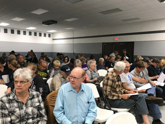 Residents of the Wood County town of Saratoga wait Wednesday evening, Sept. 26, 2019, to hear about a proposed solar project in their community.