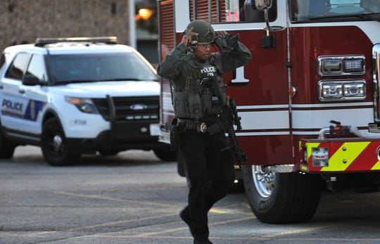 Wichita Falls police SWAT approaches the area of shots fired call and possible barricade person at an apartment building located in the 900 block of Denver Street, Thursday morning.