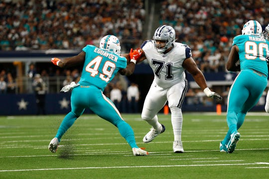 Dallas Cowboys offensive tackle La'el Collins, 71, faces off against Miami Dolphins linebacker Sam Eguavoen, 49, during the first half of an NFL football game in Arlington, Texas, on Sunday, Sept. 22, 2019.
