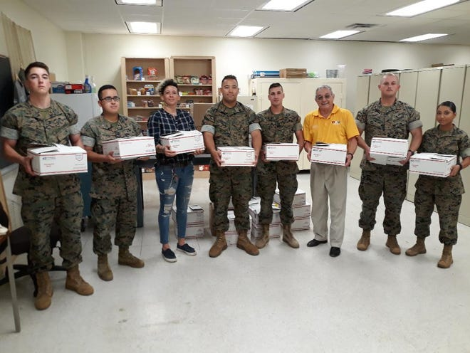 """Marine detachment at Sheppard Air Force Base along with Iraq War veteran Chrissy Perez and Cmdr. Joel Jimenez of the DAV Ch. 41 are preparing to send care packages to our troops """"Down Range."""" The DAV wants to thank the numerous sponsors for their part in stepping up and helping our troops around the world."""