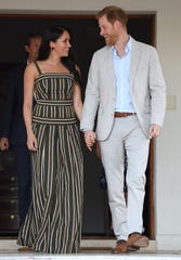Prince Harry and Duchess Meghan attend a reception for young people, community and civil society leaders at the Cape Town residence of the British High Commissioner during their royal tour of South Africa on Sept. 24.