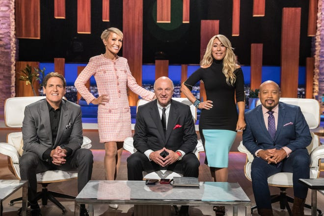 Shark investors Mark Cuban, left, Barbara Corcoran, Kevin O'Leary, Lori Greiner and Daymond John pose on the 'Shark Tank' set during a break in a long day of listening to entrepreneur's pitches.