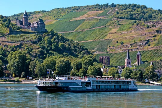 "The 128-passenger Avalon ""Suite Ship"" Avalon Artistry II, glides past castles on the Rhine."