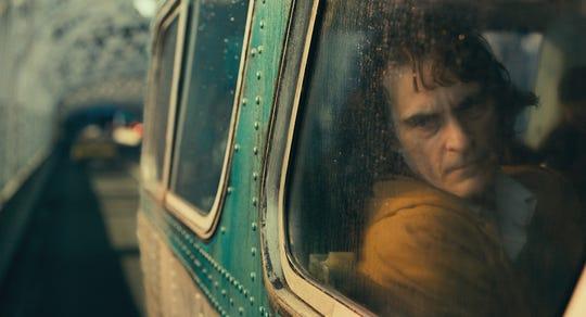 "Arthur Fleck (Joaquin Phoenix) is an outcast among his fellow Gotham City residents in ""Joker."""