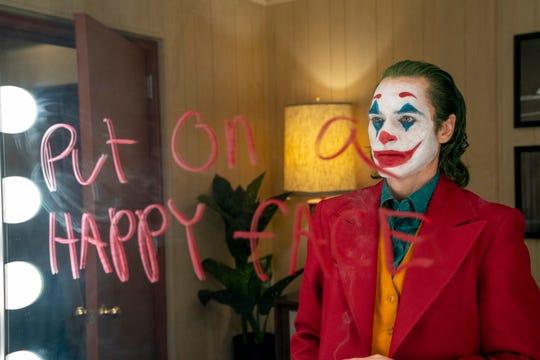 "Arthur Fleck (Joaquin Phoenix) goes down a dark, face-painted path in Todd Phillips' psychological drama ""Joker."""