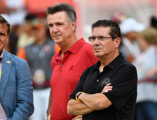 Washington Redskins president Bruce Allen (left) team owner Daniel Snyder (right) on the field before the game against the Cincinnati Bengals at FedEx Field.