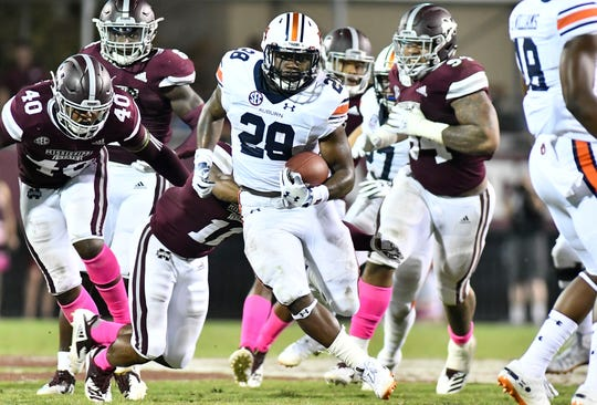 Auburn running back JaTarvious Whitlow against the Mississippi State defense during their game in 2018.