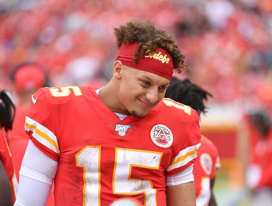 Patrick Mahomes talks to teammates on the bench during the second half vs. the Ravens at Arrowhead Stadium last Sunday.