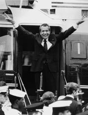 Richard Nixon says goodbye with a victorious salute to his staff members outside the White House as he boards a helicopter after resigning the presidency on Aug. 9, 1974. Nixon was the first president in American history to resign the nation's highest office. His resignation came after approval of an impeachment article against him by the House Judiciary Committee for withholding evidence from Congress. He stepped down as the 37th president with a 2,026-day term, urging Americans to rally behind Gerald R. Ford. President Ford fully pardoned Nixon one month later.