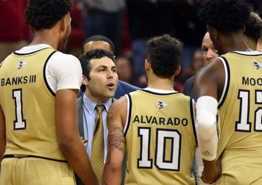 Georgia Tech coach Josh Pastner talks to his team during their 2019 ACC tournament game against North Carolina State Wolfpack at PNC Arena.