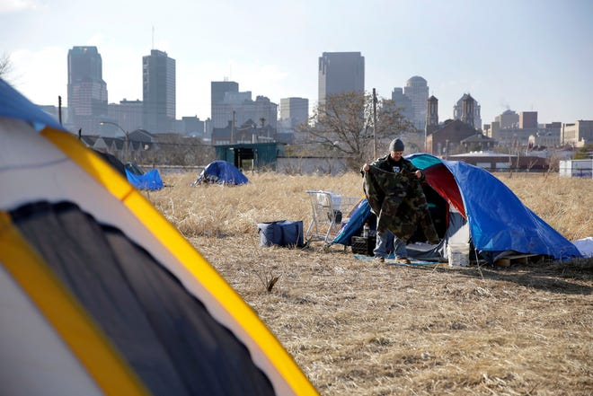 In this Tuesday, Jan. 27, 2015 file photo, Terry, cleans out his tent at a large homeless encampment, near downtown St. Louis. The gap between the haves and have-nots in the United States grew last year. Income inequality in the United States expanded from 2017 to 2018, with several heartland states among the leaders of the increase, even though several wealthy coastal states still had the most inequality overall, according to figures released Thursday, Sept. 26, 2019, by the U.S. Census Bureau.