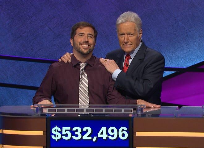 'Jeopardy!' host Alex Trebek, right, poses with the popular quiz show's most recent big winner, Jason Zuffranieri.