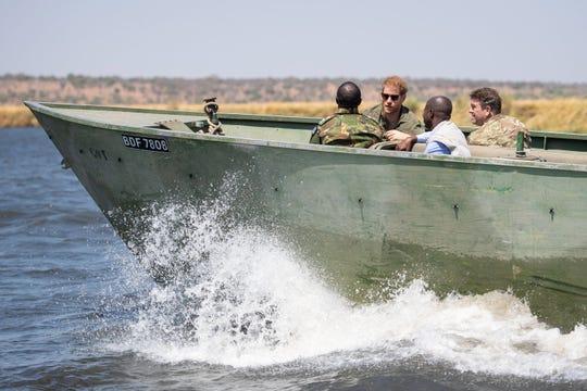 Prince Harry joins a Botswana Defense Force anti-poaching patrol on Chobe River in Chobe National Park, Kasane, Botswana, Sept. 26, 2019.