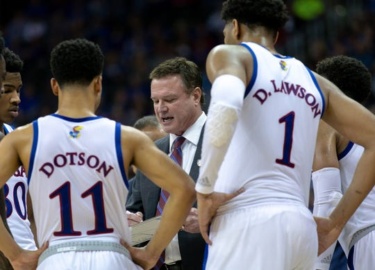 Kansas coach Bill Self huddles with his team during a timeout in their Big 12 tournament game against Texas in 2019.