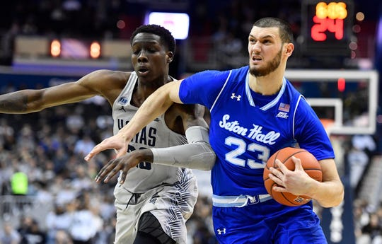 Seton Hall Pirates forward Sandro Mamukelashvili (23) drives past Georgetown Hoyas forward Josh LeBlanc (23)