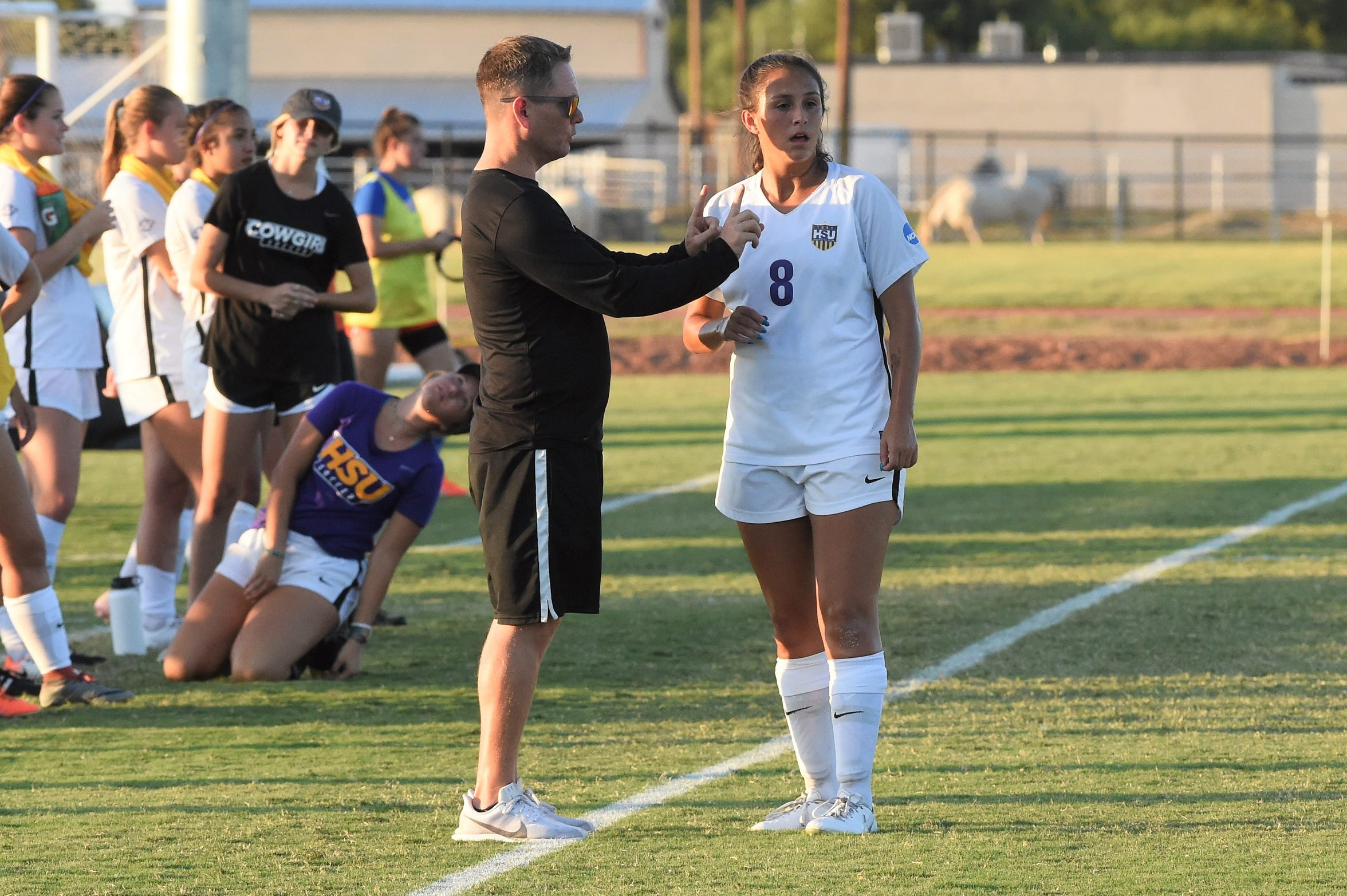 HSU head coach Marcus Wood gives Taylor Bernal (8) instructions during the game against Louisiana College at the HSU Soccer Complex on Thursday.