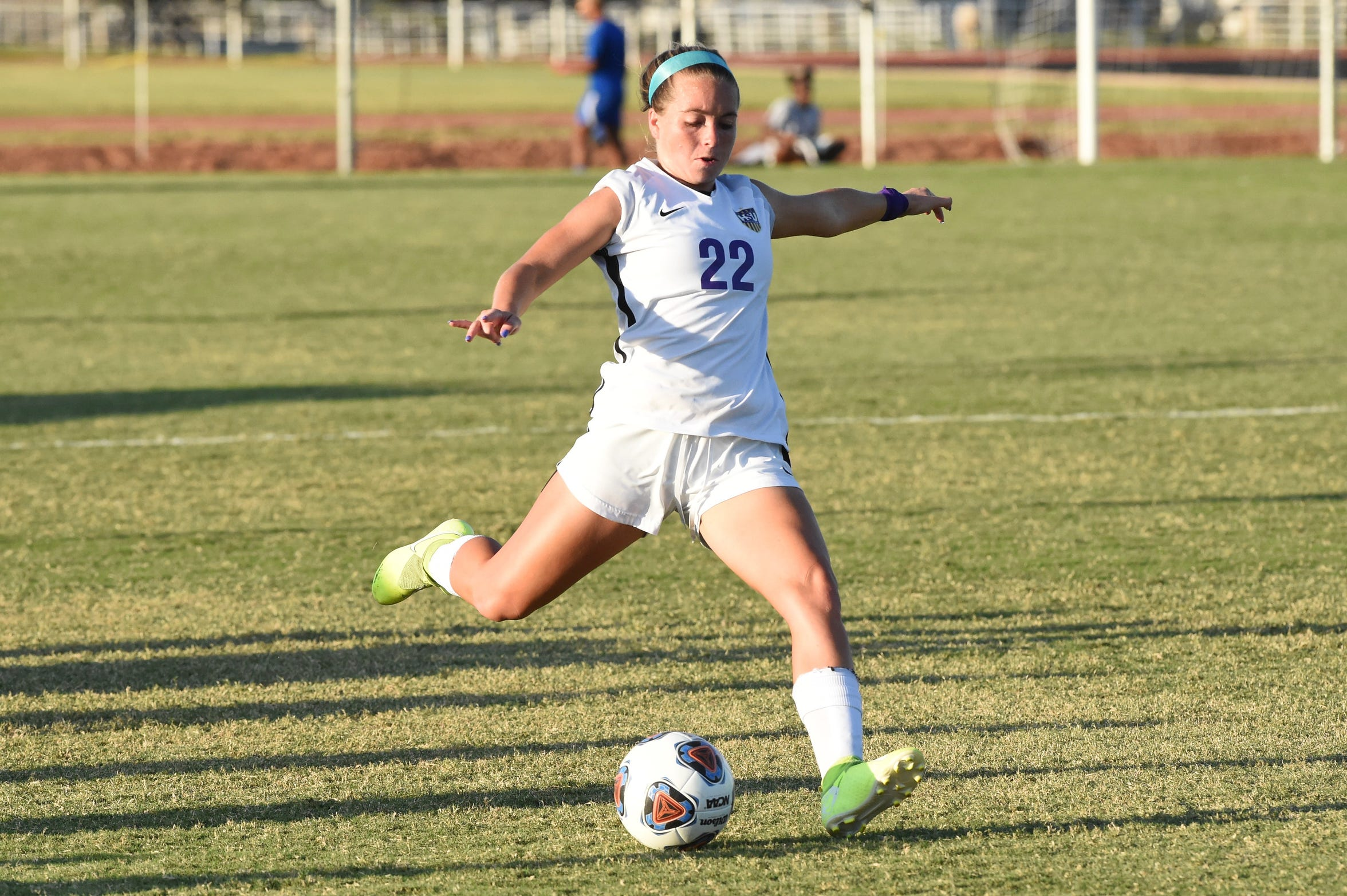 HSU's Kendell Groom (22) delivers a long pass against Louisiana College at the HSU Soccer Complex on Thursday, Sept. 26, 2019. The Cowgirls won 10-0.
