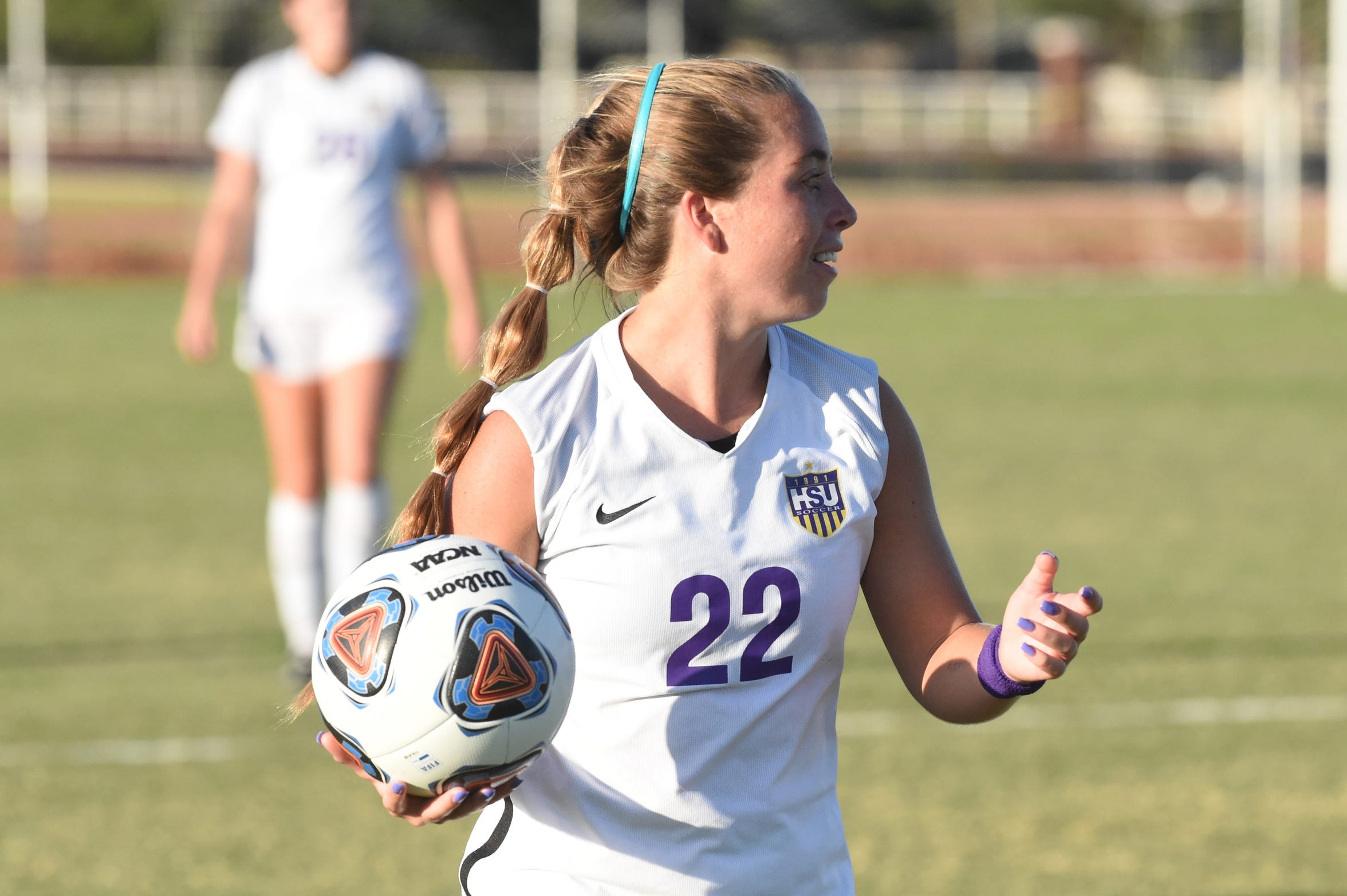 HSU's Kendell Groom (22) looks for an open player before throwing the ball in against Louisiana College at the HSU Soccer Complex on Thursday, Sept. 26, 2019. The Cowgirls won 10-0.