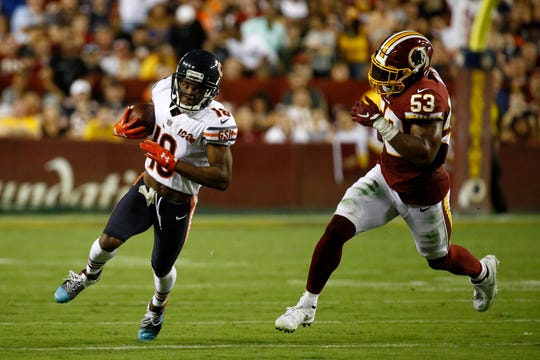 Chicago Bears wide receiver Taylor Gabriel, left, runs past Washington Redskins inside linebacker Jon Bostic during the first half Monday in Landover, Md.