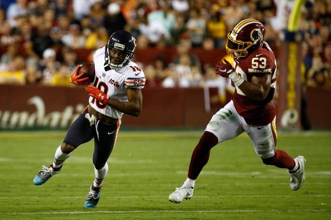 Chicago Bears wide receiver Taylor Gabriel, left, runs past Washington Redskins inside linebacker Jon Bostic during the first half Monday in Landover, Md.