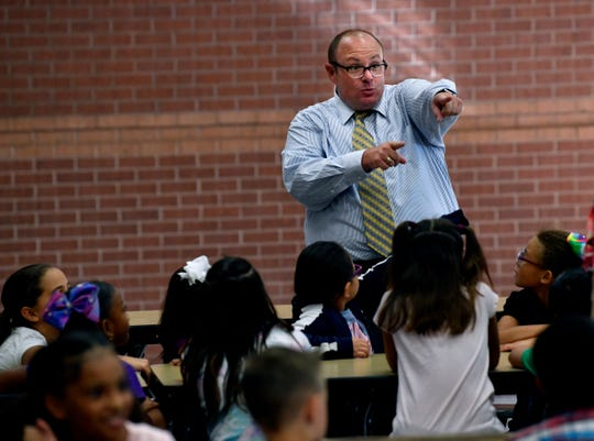 New Bowie Elementary School Assistant Principal Clay Johnson has a bit of fun with students in the cafeteria on the first day of school, Aug. 21.