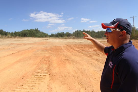 Brandon Quinn of Eden Rock Enterprises points out where homes and roads will be constructed inside the Rock Creek Village development in Mars Hill.