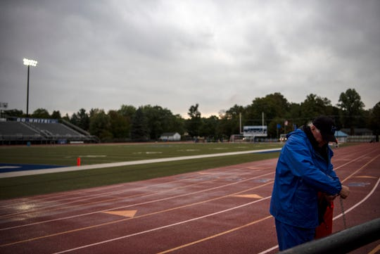 The football field at Harper Creek High School empties as their game against Pennfield is rescheduled for noon on Saturday due to lightning and mosquitos on Friday, Sept. 27, 2019 in Battle Creek, Mich.