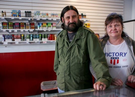 Killian and Sarah Stoddard opened Victory Vape and Coffee Shop after quitting their jobs at Harrison Medical Center. The two worry how headlines on a vaping-related illness will affect their business.