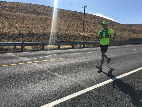 Bainbridge Islander Mike Cyger running on a leg of his journey from Seattle to Spokane.