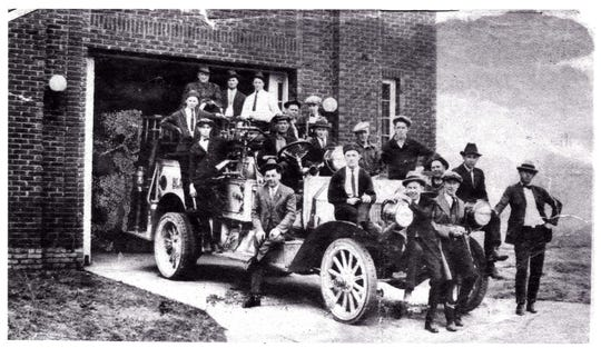 A 1922 photo shows firefighters from the Black Mountain Fire Department in front of a brick firehouse, which is currently home to the Swannanoa Valley Museum & History Center.