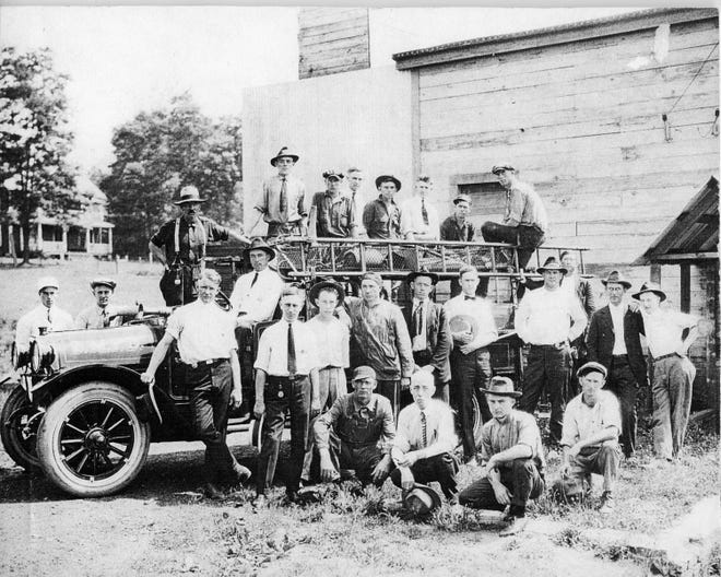 The Black Mountain Fire Department poses for a picture in front of its temporary station near the intersection of what are now known as Broadway and Sutton Avenues in 1921. The department would move into its brick firehouse the following year.