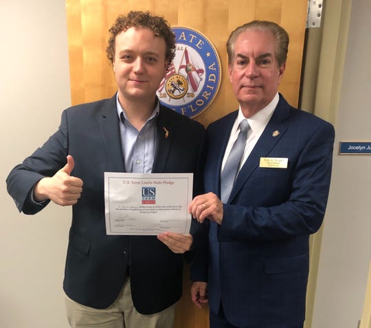 U.S. Term LimitsExecutive Director Nick Tomboulides of Cocoa, left, joined Florida Sen. Tom Wright at Wright's Titusville office to witness the term limits pledge signing.