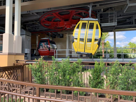 About half of almost 300 Disney Skyliner gondola cars are wrapped with character themes.