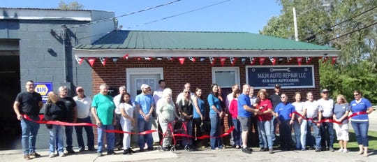 Matt and Mindy Hensley cut the ribbon at their new business, M&M Auto Repair, 301 W. Mary St.