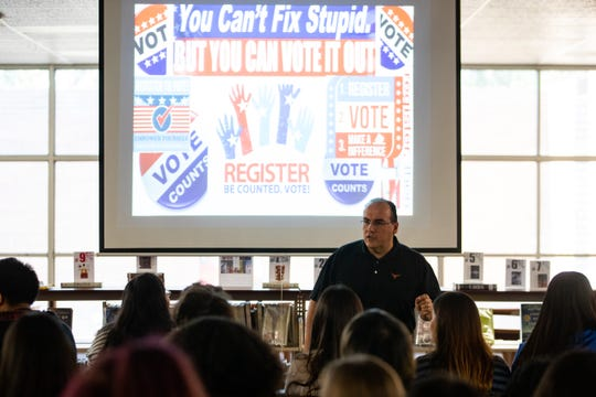 Moody High School social studies department chair Rene Saenz talks to students about voter registration on Friday, Sept. 27, 2019.