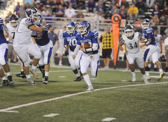 Chillicothe running back Hunter Thomas runs the ball during an 18-7 loss to Logan on Thursday, Sept. 26 at the Obadiah Harris Family Athletic Complex in Chillicothe, Ohio.