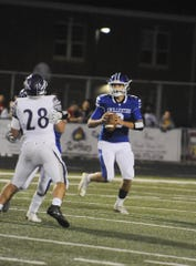 Chillicothe quarterback Christian Benson rolls out of the pocket during an 18-7 loss to Logan High School on Thursday, Sept. 26 at the Obadiah Harris Family Athletic Complex in Chillicothe, Ohio.