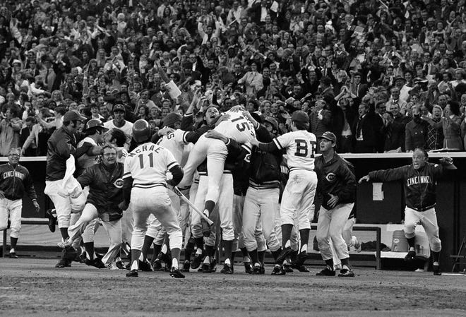 Cincinnati Reds and fans alike are jubilant in Cincinnati after George Foster (15) scored the winning run against the Pirates on a wild pitch from Bob Moose, Oct. 12, 1972, in Cincinnati.  Reds scored in the bottom of the ninth to win, 4-3.