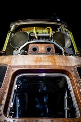 The Apollo 11 command module, Columbia, is made of aluminum alloy, stainless steel and titanium. It weighs 11,700 pounds.