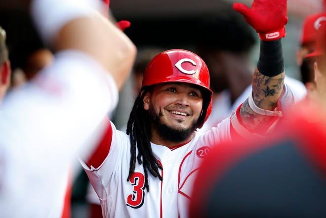 Cincinnati Reds second baseman Freddy Galvis (3) returns to the dugout after a solo home run in the second inning of the MLB National League game between the Cincinnati Reds and the San Diego Padres at Great American Ball Park in downtown Cincinnati on Monday, Aug. 19, 2019.