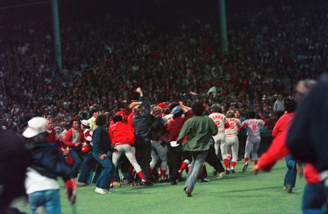 Enthusiastic fans run onto Boston Fenway Park's grass on Oct. 22, 1975 to celebrate the Cincinnati Reds' victory over the Redsox in the 1975 World Series.