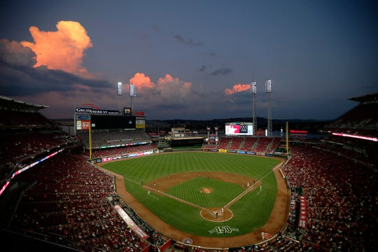 The sun sets during the fourth inning of the MLB National League game between the Cincinnati Reds and the San Diego Padres at Great American Ball Park in downtown Cincinnati on Monday, Aug. 19, 2019.