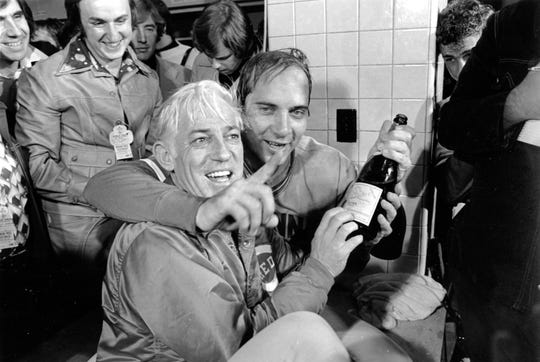 Cincinnati Reds manager Sparky Anderson and catcher Johnny Bench celebrate their victory with Champagne in the crowded dressing room at Fenway Park in Boston on Oct. 23, 1975. The Reds beat the Boston Red Sox in game seven of the World Series.