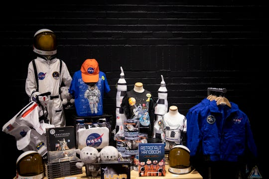 Visitors can purchase NASA souvenirs at the gift shop for the Destination Moon: The Apollo 11 Mission exhibit at the Cincinnati Museum Center. The exhibit opens September 28.