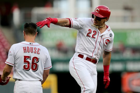 Cincinnati Reds second baseman Derek Dietrich (22) rounds the bases after hitting a 2-run home run off of Houston Astros starting pitcher Justin Verlander (35) in the first inning of the MLB interleague game between the Cincinnati Reds and the Houston Astros at Great American Ball Park in downtown Cincinnati on Tuesday, June 18, 2019.