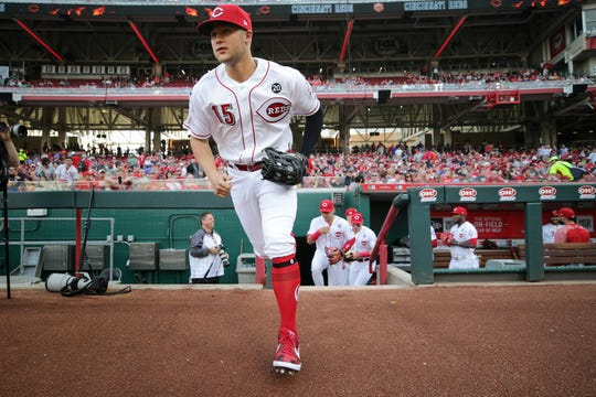 Cincinnati Reds center fielder Nick Senzel (15) takes the field for his major-league debut before the first inning during an MLB baseball game against the San Francisco Giants, Friday, May 3, 2019, at Great American Ball Park in Cincinnati.