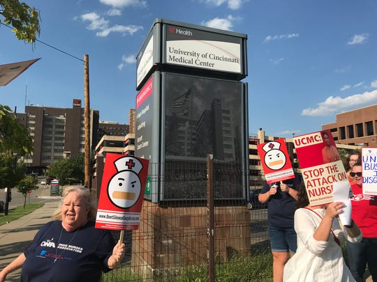 Jennifer Donaldson, a registered nurse, walks an informational picket line Sept. 10 outside the University of Cincinnati Medical Center in Corryville.