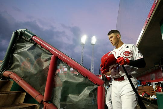 Cincinnati Reds center fielder Nick Senzel (15) walks up the dugout steps in the fourth inning during an MLB baseball game against the San Francisco Giants, Friday, May 3, 2019, at Great American Ball Park in Cincinnati.